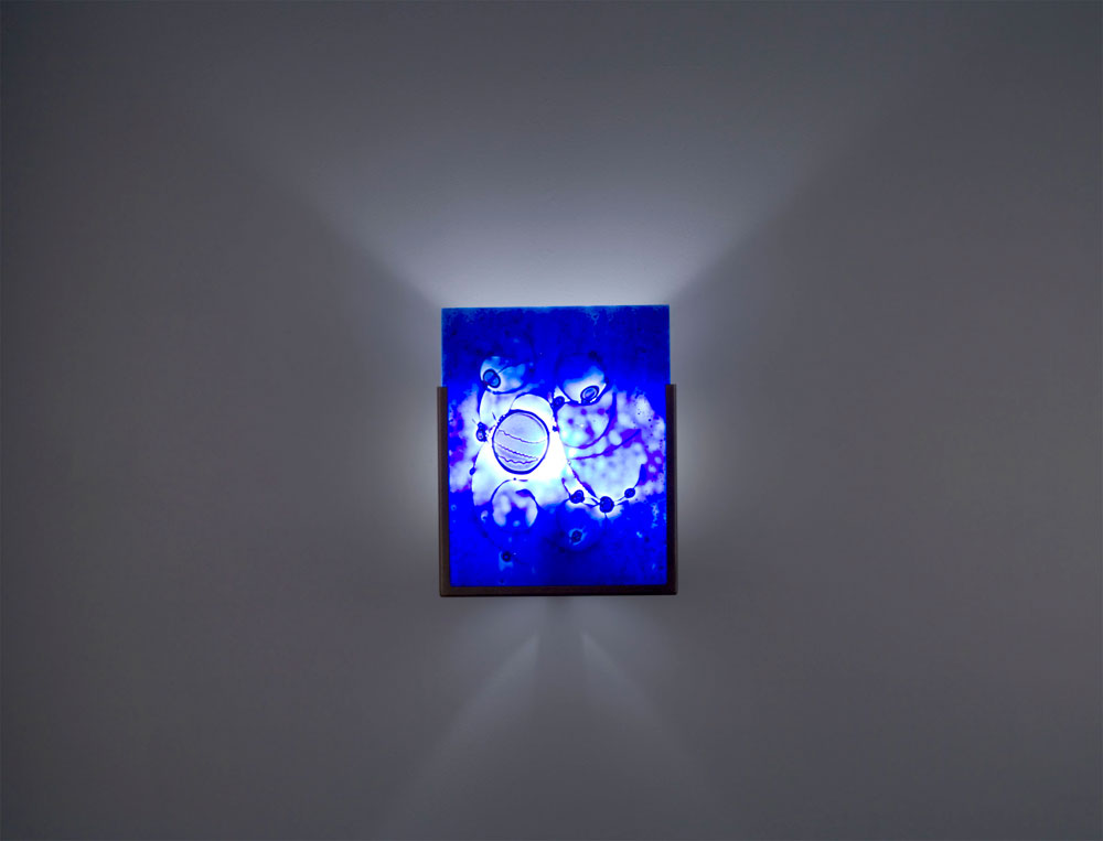 Shown in Bronze with Wired Blue glass selection with light diffuser.