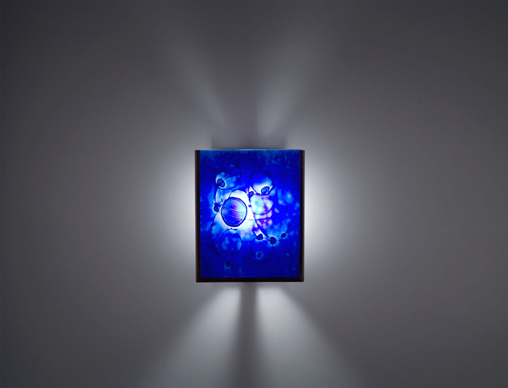 Shown in Bronze with Wired Blue glass selection and light diffuser.